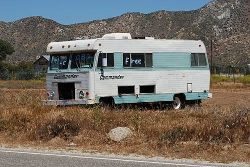 In a sign of the times, a gas-guzzling RV sits off the shoulder, free -- or best offer!