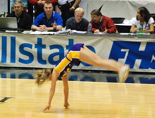 Cheerleader, mid-flip