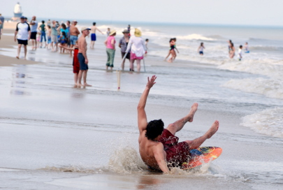 Skimboarder takes a spill