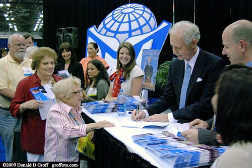 """Solly"" Sollenberger signs an autograph for Dr. Ruth Westheimer"