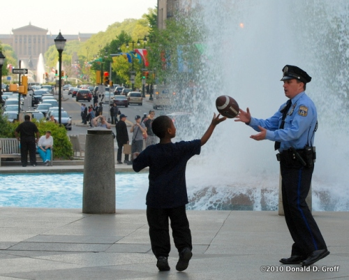 Cop as quarterback, LOVE Park, Philadelphia,  April 22, 2010