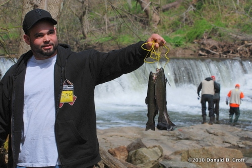 An angler presents his catch, opening day