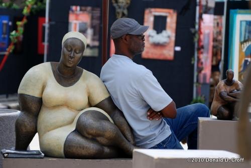 "Sculptor Nnamdi Okonkwo, with ""Resolution"""