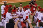 Carlos Ruize mobbed by teammates after winning home run.