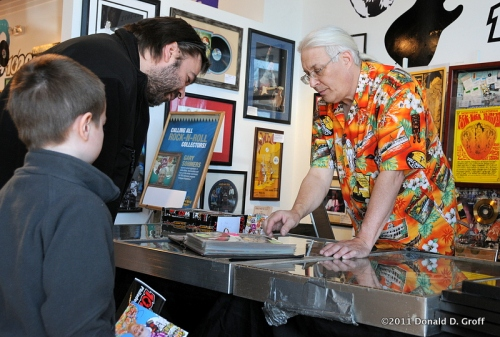 Rock & pop memorabilia appraiser Gary Sohmers at WMGK art show March 19, 2011.