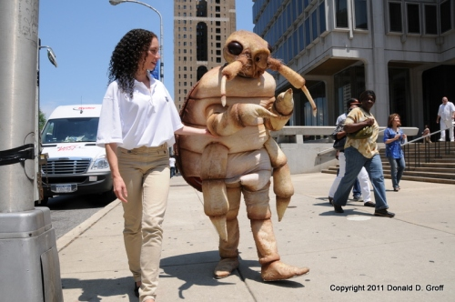 Large bedbug being escorted near LOVE Park, Philadelphia, 6/15/11