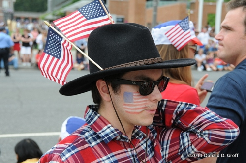 a young foreign visitors gets into the parade spirit, Philadelphia