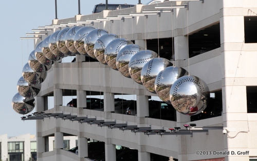 Those decorative orbs are, on closer inspection, silver baseballs attached to a parking garage outside Nationals Park.